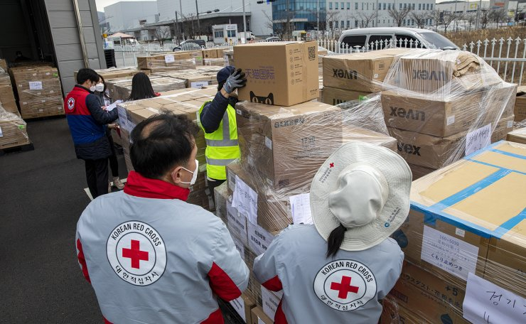Korean Red Cross employees organize mask boxes donated by Jack Ma, CEO of Alibaba Group, a Chinese multinational technology company, at the organization's Hanjin warehouse in Incheon. Ma donated 1 million masks to Korea. Korea Times photo by Sjim Hyun-chul