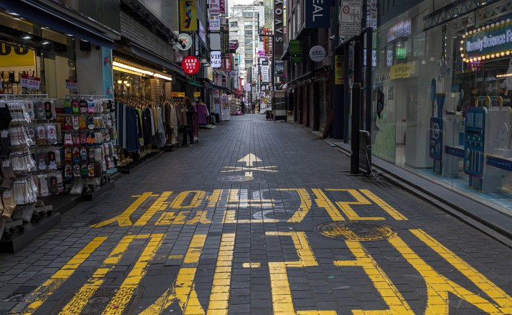 A street in Myeongdong, a famous tourist destination in Seoul, is empty, Wednesday afternoon, March 18, 2020. COVID-19 has hit businesses in Myeongdong, some of which closed indefinitely because of a sharp decline of visitors, hard. Korea Times photo by Shim Hyun-chul
