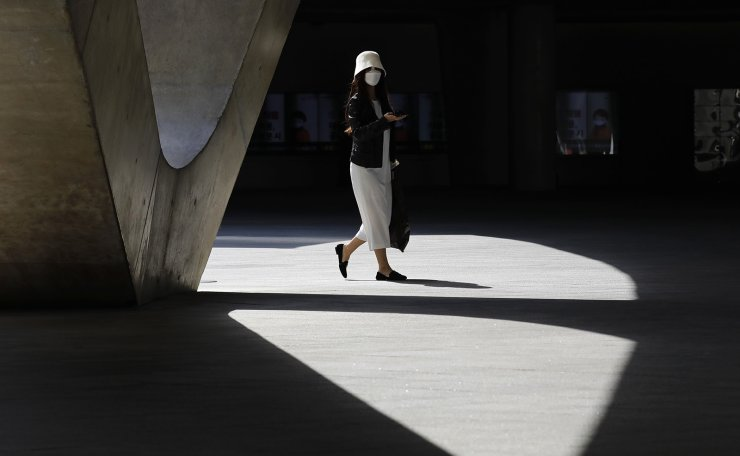 A woman is seen wearing a face mask at Dongdaemun Design Plaza in Seoul, South Korea, Thursday, March 19, 2020.  Korea Times photo by Shium Hyun-chul