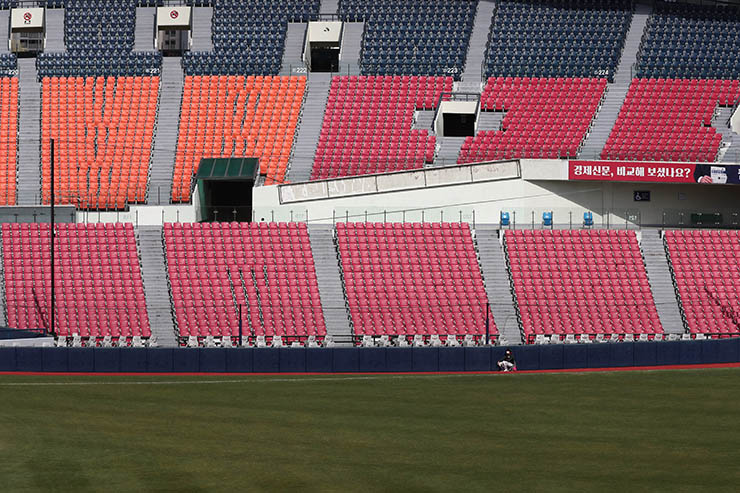 Stadium seats are empty as a part of precaution against the new coronavirus during the pre-season baseball game between Doosan Bears and LG Twins in Seoul, South Korea, Tuesday, April 21, 2020. South Korea's professional baseball league has decided to begin its new season on May 5, initially without fans, following a postponement over the coronavirus. Korea Times photo by Shim Hyun-chul