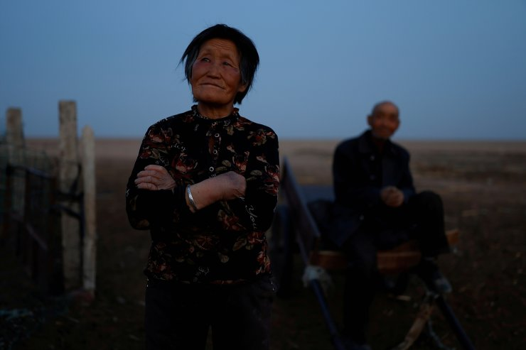 Shepherds Ding Yinhua, 69, and her husband Li Youfu, 71, pose for a picture outside their house in the Gobi desert in Minqin county, Wuwei, Gansu province, China, April 17, 2021. Tree-planting has been at the heart of China's environmental efforts for decades as the country seeks to turn barren deserts and marshes near its borders into farmland. Li said he thought tree-planting had made no difference at all. 'The sand is still moving. This can't be controlled,' he said. 'When the wind comes, it's usually really strong. No one can stop it.' REUTERS