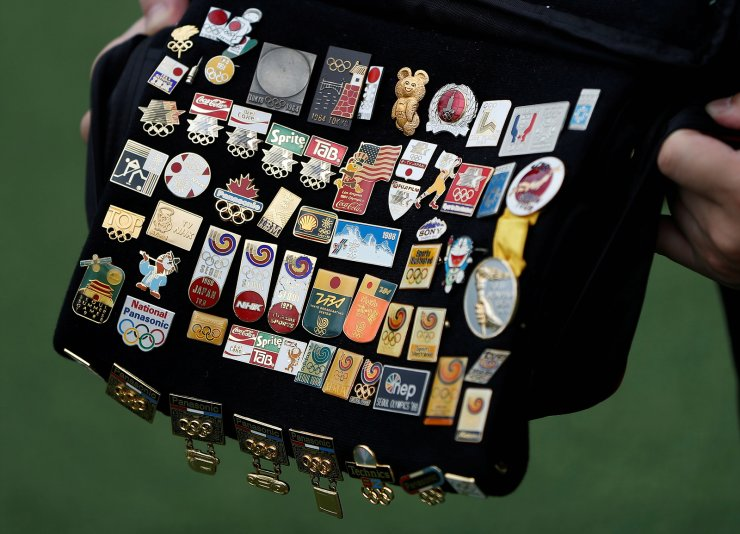 Yoshiyuki Terajima (51), a pin collector based in Tokyo, shows his Olympic pin collection near the National Stadium, the main stadium for the 2020 Tokyo Olympic Games that have been postponed to 2021 due to the coronavirus disease (COVID-19) pandemic, in Tokyo, Japan June 13, 2021. Picture taken June 13, 2021. REUTERS