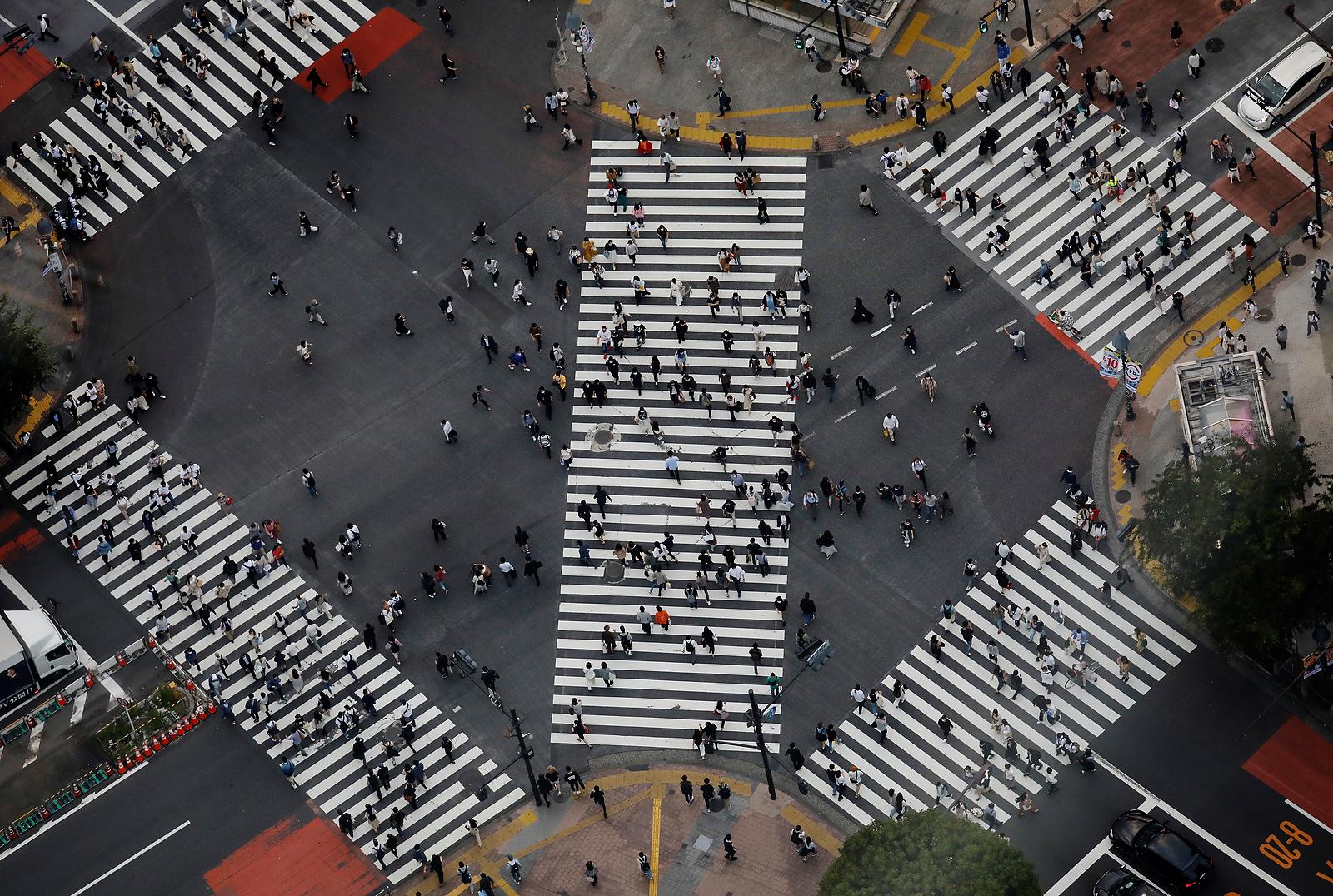 People walk across the Shibuya crossing in Tokyo, Japan, June 1, 2021. REUTERS