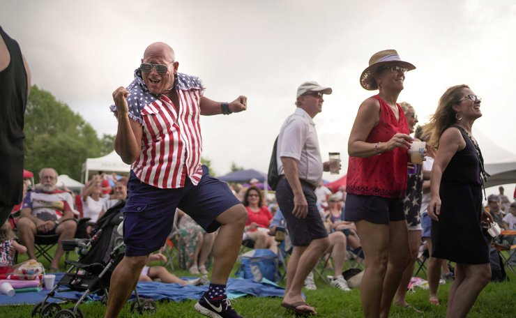Billy Klaus, of Hammond, dances during the Light up the Lake Independence Day Celebration at the Mandeville Lakefront in Mandeville, Louisiana, U.S., July 4, 2021.  REUTERS