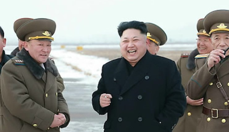 North Korean leader Kim Jong-un smokes a cigarette during a flight combat drill of the Korean People's Army in this image released by the North's state media, Saturday.  (Yonhap)
