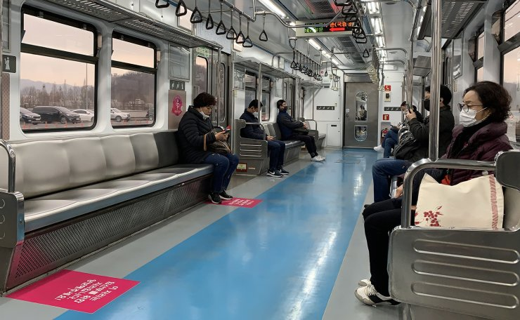 Passengers with face masks are seen keeping 'Social Distance' in the subway car in Seoul, Monday, March. 09, 2020. Korea Times photo by Choi Won-suk