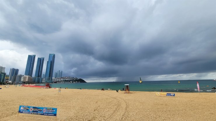 A beach in Busan remains cloudy on Aug. 8, 2021, as the tropical storm Lupit approaches Japan. Yonhap