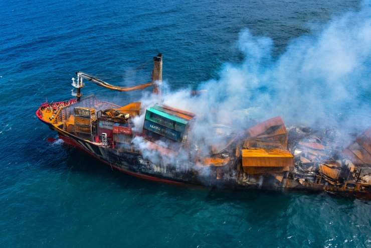 Smoke rises from a fire onboard the MV X-Press Pearl vessel as it sinks while being towed into deep sea off the Colombo Harbour, in Sri Lanka June 2, 2021. REUTERS