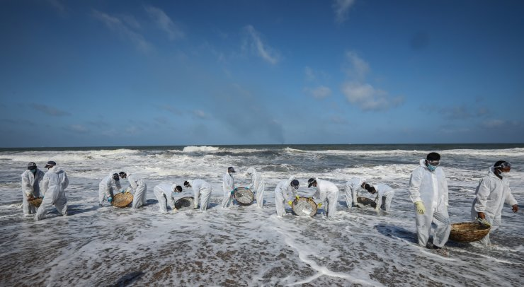 Sri Lanka Navy personnel, wearing protective gear, clear the beach from debris and other materials that washed ashore from the crippled container cargo vessel  MV X-Press Pearl, on the beach of Negombo, north-west of Colombo, Sri Lanka, June, 2, 2021. EPA