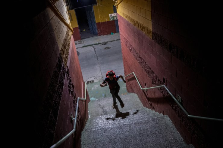 A migrant runs after crossing into the Spanish enclave of Ceuta, near the border of Morocco and Spain, early Wednesday, May 19, 2021. AP