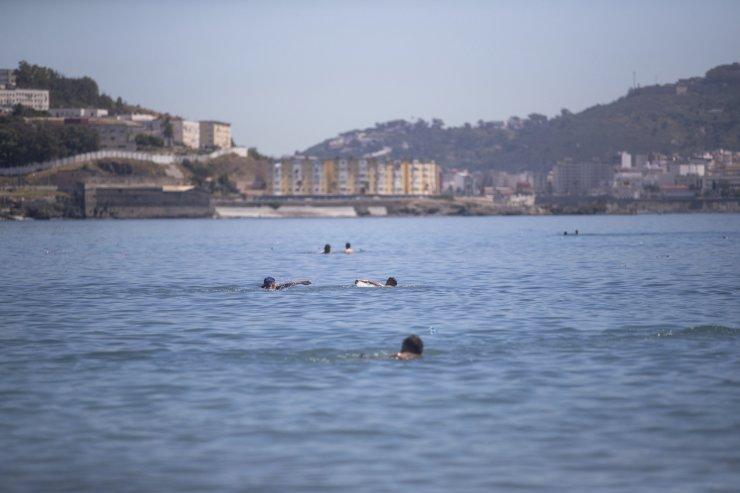 Moroccan boys swim from the Moroccan border town of Fnideq towards the Spanish enclave of Ceuta, on Wednesday, May 19, 2021. Spain's north African enclave of Ceuta has awakened to a humanitarian crisis after thousands of migrants who crossed over from Morocco spent the night sleeping where they could find shelter. AP