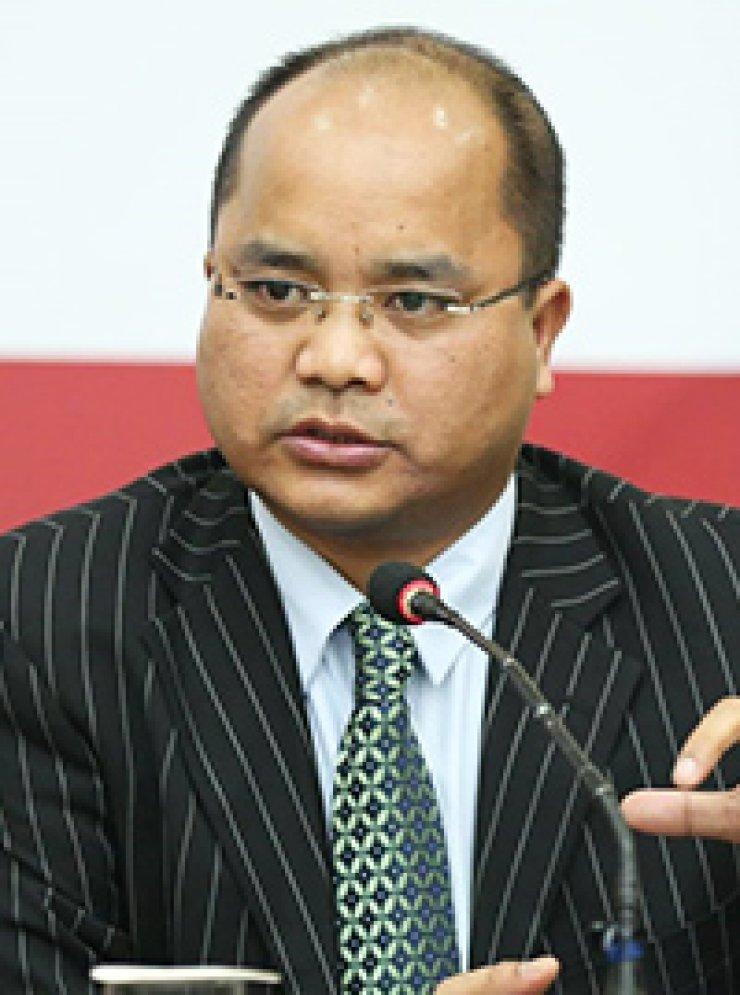 Dr. Nehginpao Kipgen Diksha Shandilya