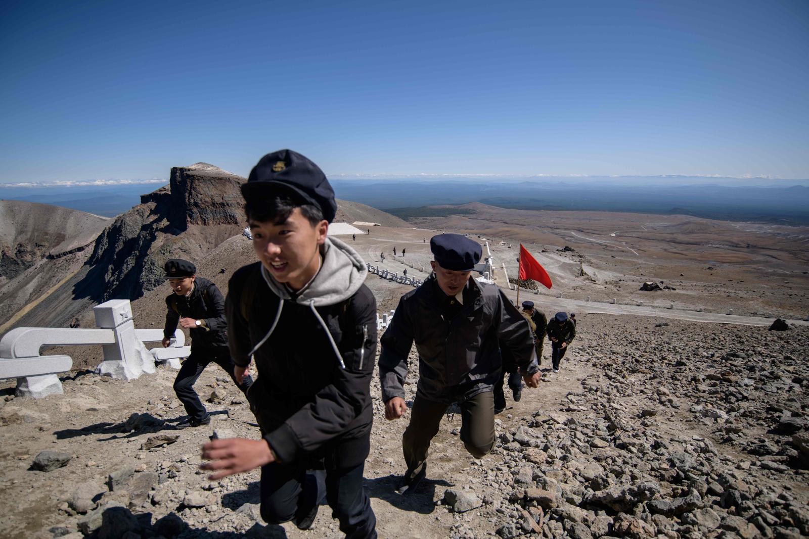 In a photo taken on September 11, 2019, North Korean students march to the summit of Mount Paektu, near Samjiyon. AFP