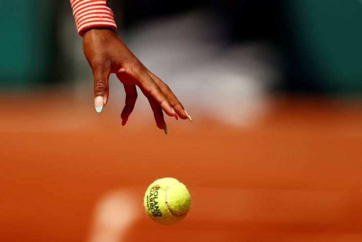 General view as the hand of Cori Gauff of the U.S. is seen during her fourth round match against Tunisia 's Ons Jabeur at Roland Garros in Paris, France, June 7. REUTERS