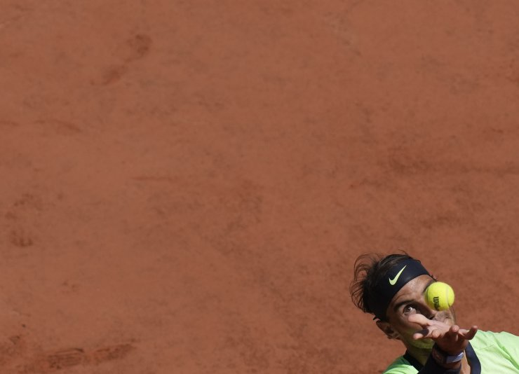 Spain's Rafael Nadal serves to Australia's Alexei Popyrin during their first round match on day three of the French Open tennis tournament at Roland Garros in Paris, France, Tuesday, June 1, 2021. AP