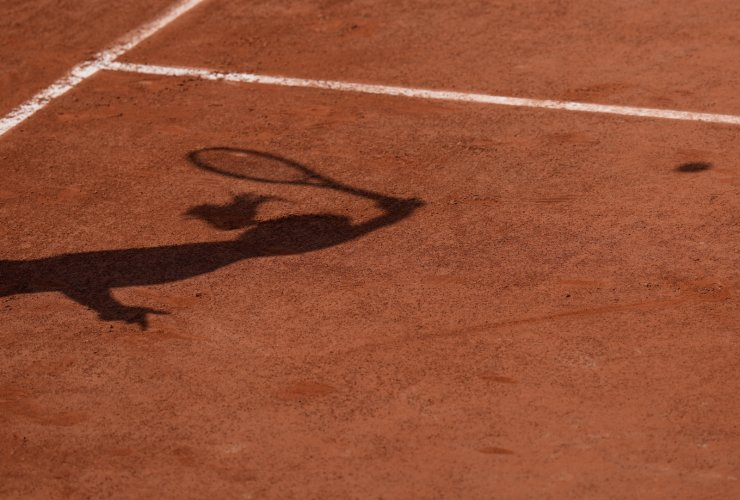 The shadow of Switzerland's Belinda Bencic as she serves to Russia's Daria Kasatkina during their second round match on day four of the French Open tennis tournament at Roland Garros in Paris, France, Wednesday, June 2, 2021. AP