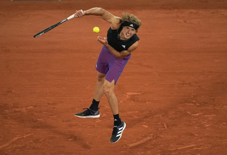 Germany's Alexander Zverev serves to Japan's Kei Nishikori during their fourth round match on day 8, of the French Open tennis tournament at Roland Garros in Paris, France, Sunday, June 6, 2021. AP