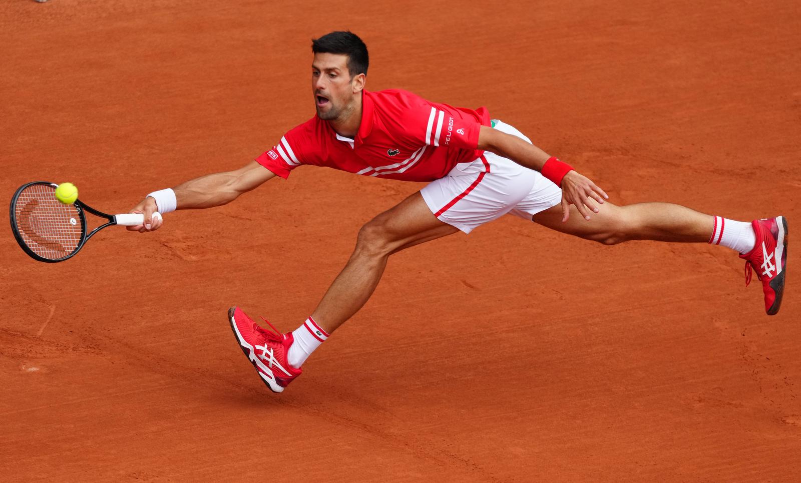Novak Djokovic returns the ball during the men's singles third round match between Novak Djokovic of Serbia and Ricardas Berankis of Lithuania at the French Open tennis tournament at Roland Garros in Paris, France, June 5, 2021. Xinhua