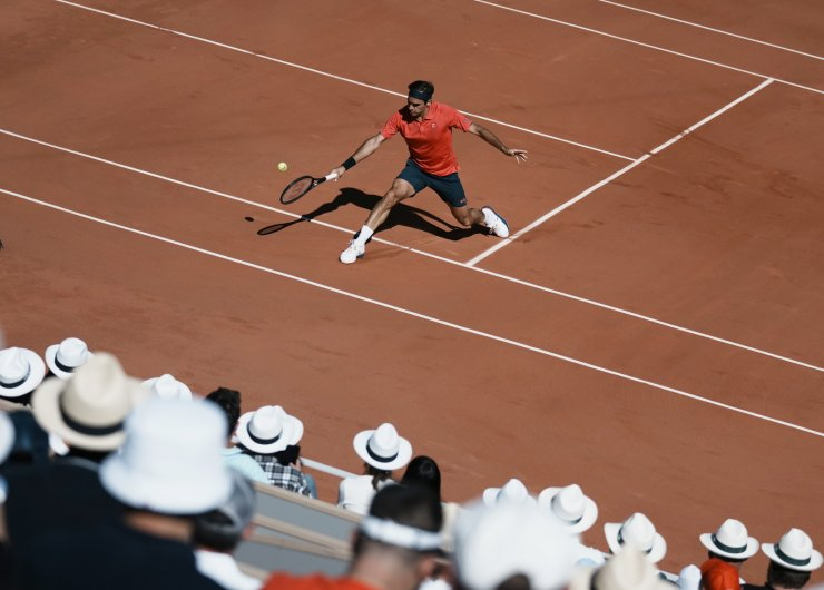 Switzerland's Roger Federer plays a return to Uzbekistan's Denis Istomin during their first round match on day two of the French Open tennis tournament at Roland Garros in Paris, France, Monday, May 31, 2021. AP