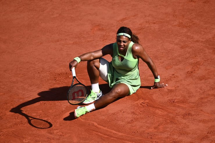 Serena Williams of the US reacts as she plays against Kazakhstan's Elena Rybakina during their women's singles fourth round tennis match on Day 8 of The Roland Garros 2021 French Open tennis tournament in Paris on June 6, 2021. AFP