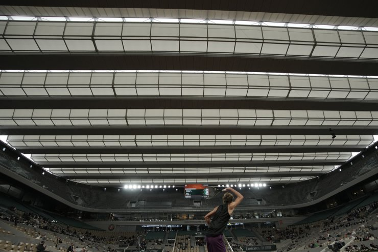 Germany's Alexander Zverev plays a return to Serbia's Laslo Djere during their third round match on day 6, of the French Open tennis tournament at Roland Garros in Paris, France, Friday, June 4, 2021. The game is continuing to be being played under the roof on Philippe Chatrier court as rain falls and delays the other match at Roland Garros. AP