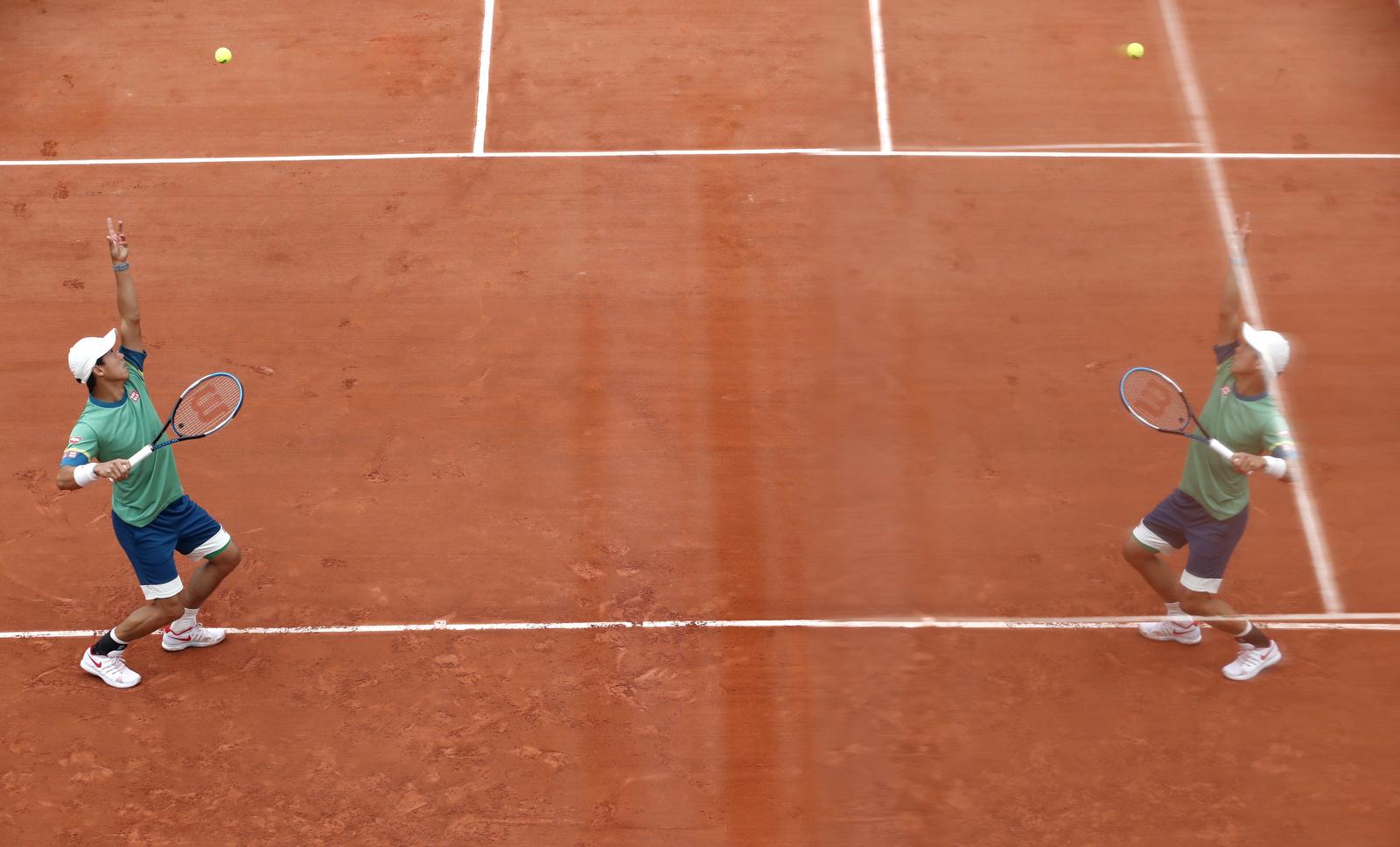 Japan's Kei Nishikori in action during his third round match against Switzerland's Henri Laaksonen at Roland Garros in Paris, France, June 4. REUTERS