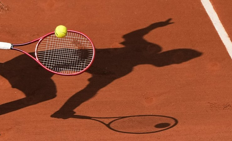 Croatia's Marin Cilic plays a return to Switzerland's Roger Federer during their second round match on day 5, of the French Open tennis tournament at Roland Garros in Paris, France, Thursday, June 3, 2021. AP