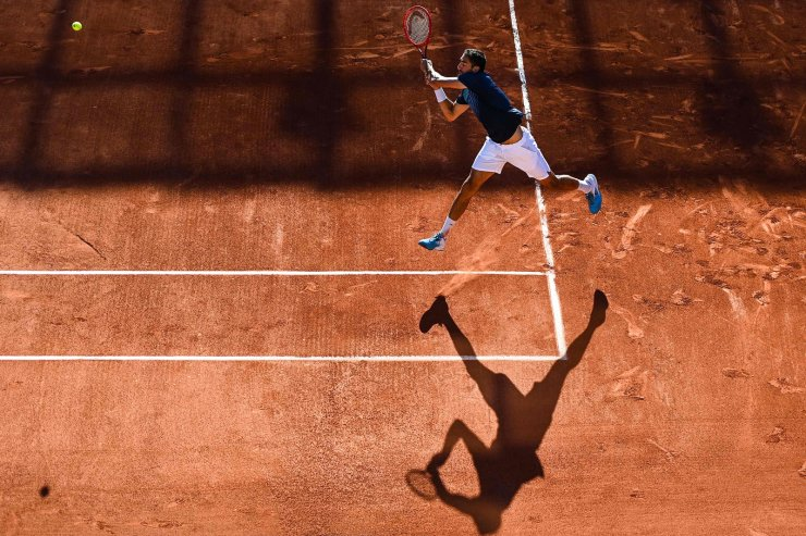 Croatia's Marin Cilic returns the ball to France's Arthur Rinderknech during their men's singles first round tennis match against at court Simonne-Mathieu on Day 2 of The Roland Garros 2021 French Open tennis tournament in Paris on May 31, 2021. AFP