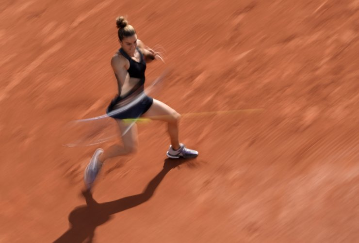 Maria Sakkari of Greece plays a return to Belgium's Elise Mertens during their third round match on day 7, of the French Open tennis tournament at Roland Garros in Paris, France, Saturday, June 5, 2021. AP
