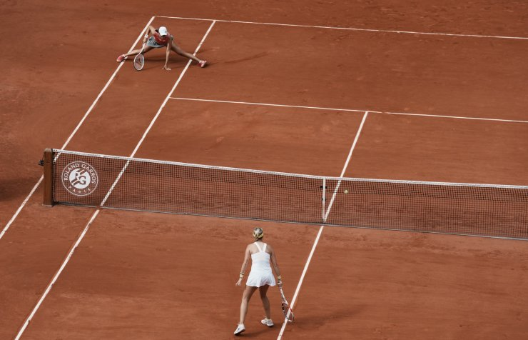 Estonia's Anett Kontaveit, bottom right, watches as Poland's Iga Swiatek fails to return the ball during their third round match on day 7, of the French Open tennis tournament at Roland Garros in Paris, France, Saturday, June 5, 2021. AP