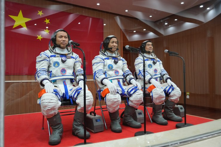 Astronauts Nie Haisheng (C), Liu Boming (R) and Tang Hongbo attend a see-off ceremony for Chinese astronauts of the Shenzhou-12 manned space mission at the Jiuquan Satellite Launch Center in northwest China, June 17, 2021. Xinhua