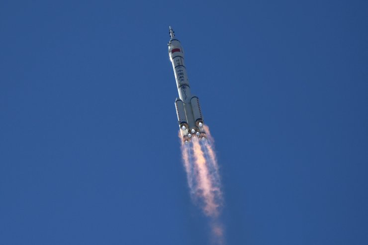 A Long March-2F carrier rocket, carrying the Shenzhou-12 spacecraft and a crew of three astronauts, heads to orbit after lifting off from the Jiuquan Satellite Launch Centre in the Gobi desert in northwest China on June 17, 2021, the first crewed mission to China's new space station. AFP