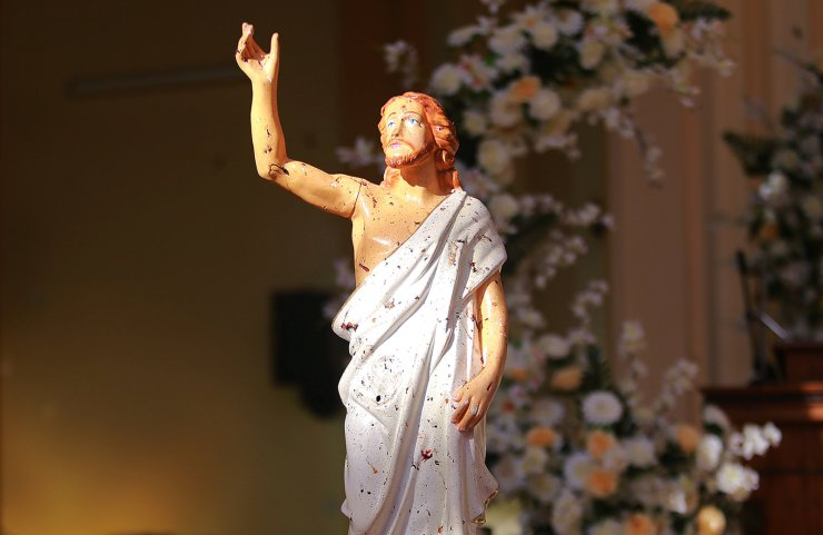 Blood stains are seen on a statue of Jesus Christ after a bomb blast inside a church in Negombo, Sri Lanka April 21, 2019. Reuters