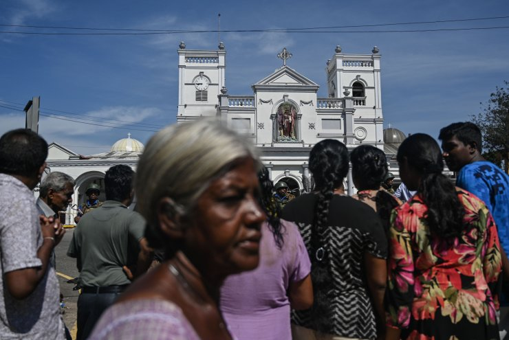 Local residents gather outside the St. Anthony's Shrine in Colombo on April 22, 2019. AFP