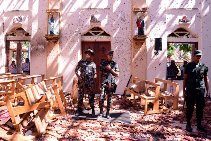 Sri Lankan soldiers look on inside the St Sebastian's Church at Katuwapitiya in Negombo on April 21, 2019, following a bomb blast during the Easter service that killed tens of people. AFP