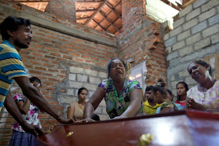 Lalitha, center, weeps beside the coffin with the remains of 12-year old niece, Sneha Savindi, who was a victim of Easter Sunday bombing at St. Sebastian Church, after it returning home in Negombo, Sri Lanka, Monday, April 22, 2019. Easter Sunday bombings of churches, luxury hotels and other sites was Sri Lanka's deadliest violence since a devastating civil war in the South Asian island nation ended a decade ago. AP