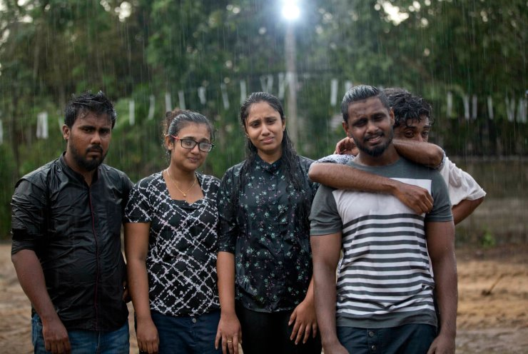 Mourners grieve at the burial of three members of the same family victims of Easter Sunday bomb blast at St. Sebastian Church in Negombo, Sri Lanka, Monday, April 22, 2019. AP