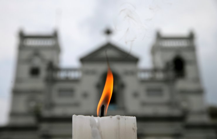 A candle burns outside St. Anthony's Shrine a week after a string of suicide bomb attacks across the island on Easter Sunday, in Colombo, Sri Lanka April 28, 2019. Reuters