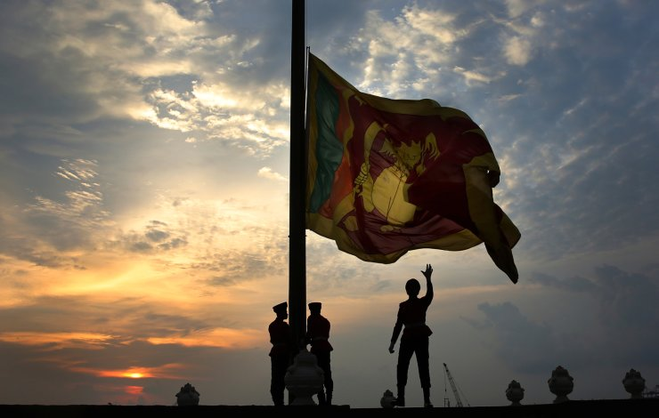 Sri Lankan Army soldiers lower the national flag as the sun sets on Sunday, in Colombo, Sri Lanka, April 28, 2019. In a rare show of unity, Sri LankanPresident Maithripala Sirisena, Prime Minister Ranil Wickremesinghe and opposition leader Mahinda Rajapaksa attended the Sunday Mass in person. Their political rivalry and government dysfunction are blamed for a failure to act upon near-specific information received from foreign intelligence agencies that preceded the bombings, which targeted three churches and three luxury hotels. AP
