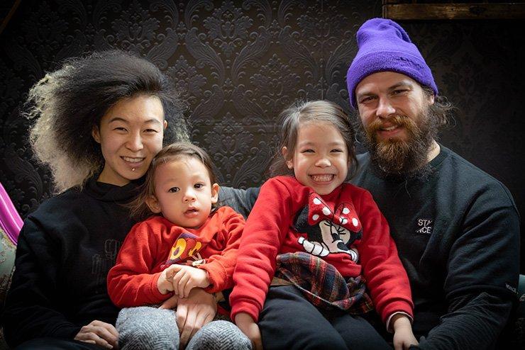 Sunya (left), Loren (right) and their two children Anika and Neptune.