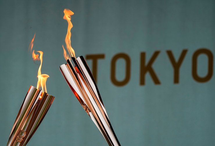Torches are pictured during a lighting ceremony after the torch relay on a public road was cancelled due to the coronavirus disease (COVID-19) pandemic, at the Tokyo 2020 Olympic torch relay celebration in Tokyo, Japan, July 9. REUTERS