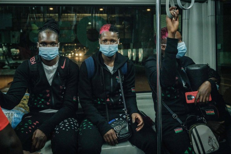 Players of kenya's volleyball national team pose in a bus at Hamad International Airport in Doha on July 8, 2021, as they transit to Japan to attend Tokyo 2020 Olympic games. AFP
