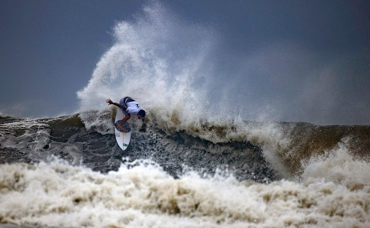 Brazil's Gabriel Medina rides a wave during the quarterfinals of the men's surfing competition at the 2020 Summer Olympics, Tuesday, July 27, 2021, at Tsurigasaki beach in Ichinomiya, Japan. AP