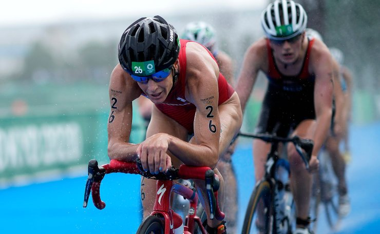 Nicola Spirig of Switzerland (26) competes on the bike leg during the women's individual triathlon competition at the 2020 Summer Olympics, Tuesday, July 27, 2021, in Tokyo, Japan. AP