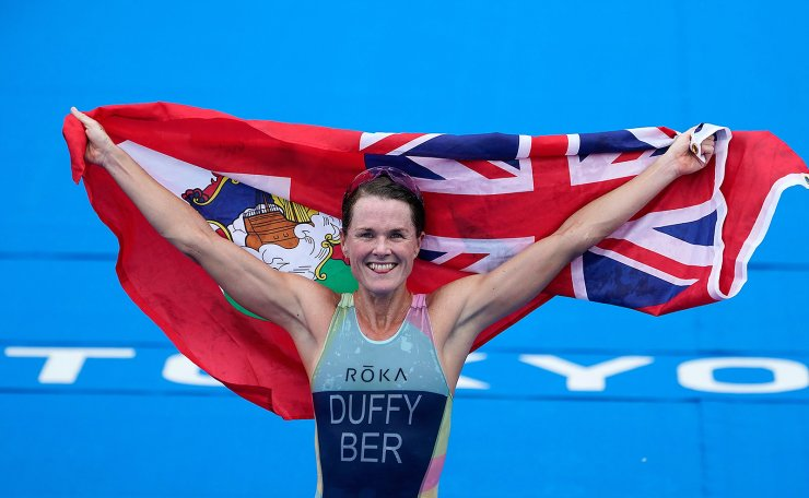Flora Duffy of Bermuda celebrates her gold medal victory in the women's individual triathlon competition at the 2020 Summer Olympics, Tuesday, July 27, 2021, in Tokyo, Japan. AP