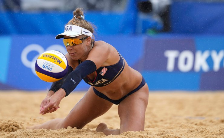April Ross, of the United States, dives to return a shot during a women's beach volleyball match against Spain at the 2020 Summer Olympics, Tuesday, July 27, 2021, in Tokyo, Japan. AP