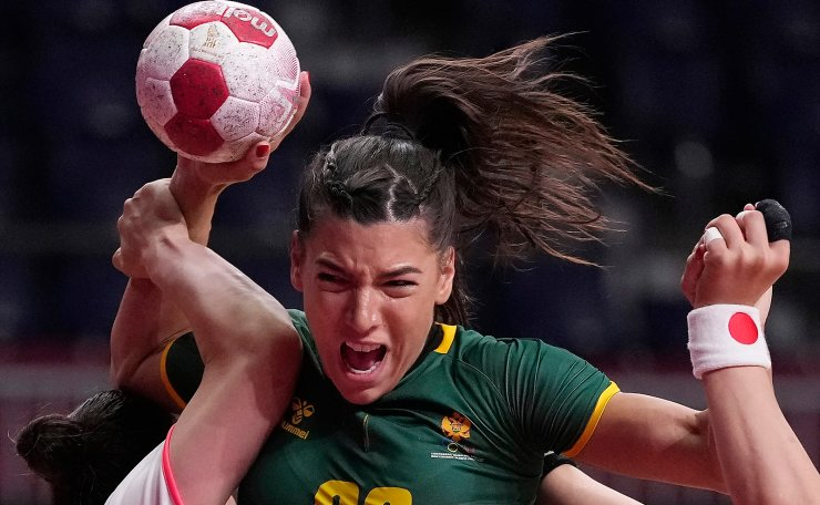 Montenegro's Itana Grbic tries to score during the women's Preliminary Round Group A handball match between Japan and Montenegro at the 2020 Summer Olympics, Tuesday, July 27, 2021, in Tokyo, Japan. AP