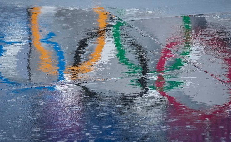 The Olympic Rings are seen reflected in water at the BMX Freestyle course after a training session was cancelled due to rain, at the 2020 Summer Olympics, Tuesday, July 27, 2021, in Tokyo, Japan. AP