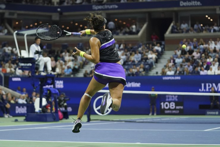 Bianca Andreescu, of Canada, returns a shot to Belinda Bencic, of Switzerland, during the semifinals of the U.S. Open tennis championships Thursday, Sept. 5, 2019, in New York. AP