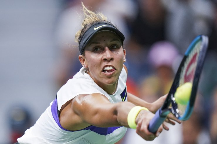 Madison Keys returns to Elina Svitolina, of Ukraine, during round four of the U.S. Open tennis championships Sunday, Sept. 1, 2019, in New York. AP